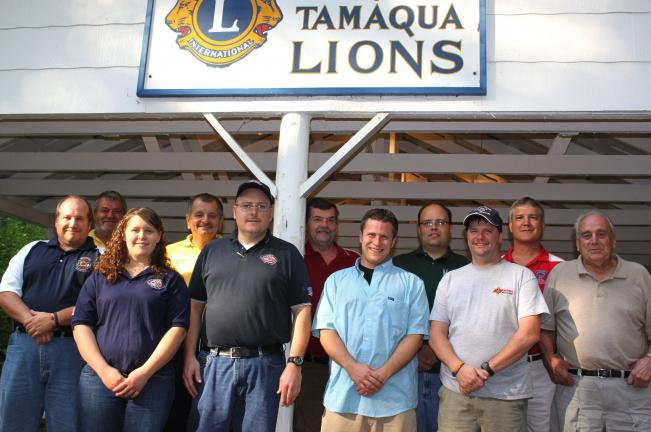 ANDREW LEIBENGUTH/TIMES NEWS Pictured from front left are Chief Mark Bower, South Ward Fire Company; EMTs Captain Amber Stahler and Chief Engineer Shawn Phillips, Tamaqua Ambulance; President Brian Keich, Tamaqua Lions Club; Ed Boerner, Tamaqua…