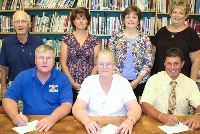 ANDY LEIBENGUTH/TIMES NEWS Back row from left are Men of Marian members Jack Malarkey, Membership Chairman; Annette Boyle, Vice President; Sue Ann Gerhard, treasurer and Marian HS Director of Development; and Debby McKinley, secretary. Front row…