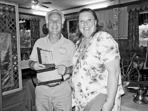 SPECIAL TO THE TIMES NEWS West End Rotary Club President Karin-Susan Breitlauch presented member Jim Mannello with the Service Above Self Award.