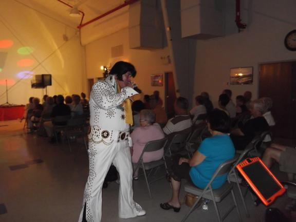 "KATIE WARGO/SPECIAL TO THE TIMES NEWS Award winning tribute artist Johnny M entertains crowds during his ""Elvis and Friends"" benefit concert at the Summit Hill Community Center last Saturday. He was joined by tribute artists Donna Maxon as Bette…"