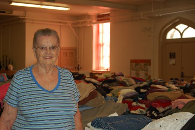 ABBY MASENHEIMER/TIMES NEWS Lutheran Church of St. John in the Heights clothing giveaway volunteer Miram Borosh helped fold and sort all of the donations for this year's free clothing drive for the needy.