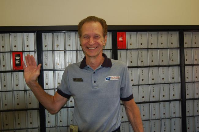"LINDA KOEHLER/TIMES NEWS Postmaster Larry Kachmar waves ""Good-bye"" to all his friends at the Kresgeville Post Office as he retires after 38 years with the United States Postal Service."