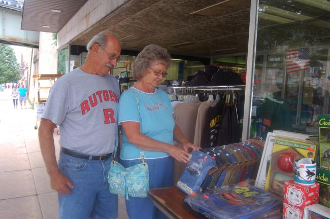 TERRY AHNER/TIMES NEWS Roger and Eileen Mriss of Lehighton sift through various items outside Shea's Hardware Store during the annual Sidewalk Sale in Palmerton on Thursday.
