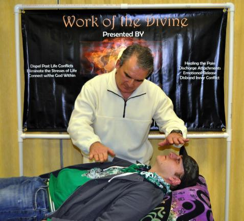 TN FILE PHOTO/DONALD R. SERFASS Reiku Master Steve Platko performs a cleansing technique on an attendee at the 2010 Tamaqua New Age Expo. Platko will return, along with many others, on Aug. 20 for the Second Tamaqua New Age Expo to take place free…