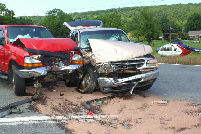 ANDREW LEIBENGUTH/TIMES NEWS Two people were lifeflighted following a head-on collision that occurred yesterday after 1 p.m. at the SR443 and SR309 intersection in West Penn.