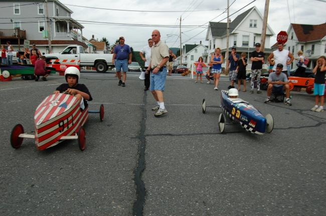 Gail Maholick/TIMES NEWS Devin Frantz, left, and Garry Goodhile, race in soapbox derbies on Third Street, Lehighton, on Saturday afternoon.