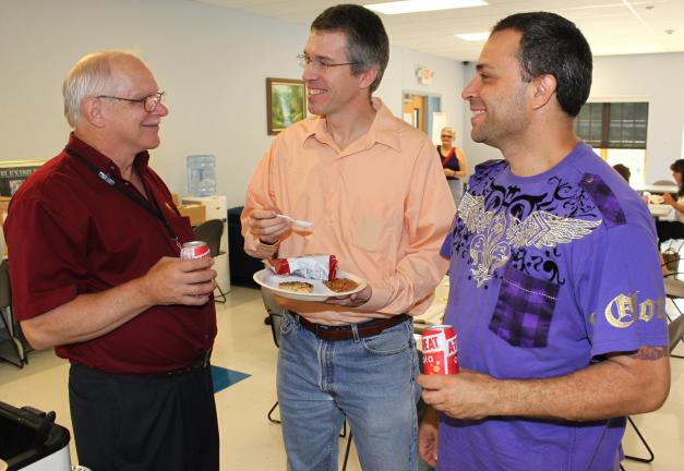 ANDREW LEIBENGUTH/TIMES NEWS Pictured during the open house discussing the prospects of entrepreneurship, from left, are Bruce Kemmerer, Entrepreneur Education Specialist, BEC; Tim Sverduk, Nesquehoning, owner of MothersAgainstLaziness.org; and…