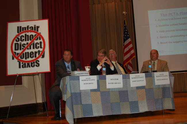 CHRIS PARKER/TIMES NEWS State Rep. Seth Grove, state Sen. David G. Argall, state Rep. Jerry Knowles and state Rep. Doyle Heffley listen to questions at a property tax hearing Thursday in Lehighton.