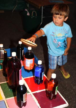 ANDREW LEIBENGUTH/TIMES NEWS Pictured playing a game of soda ring toss is Nicholas Shigo, 3, of McAdoo.