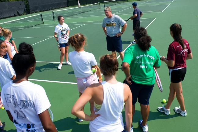 BOB FORD/TIMES NEWS Pleasant Valley girls tennis coach Mark Allison talks to team members during a practice before the season gets under way. Allison greeted 25 girls out for the team this fall.