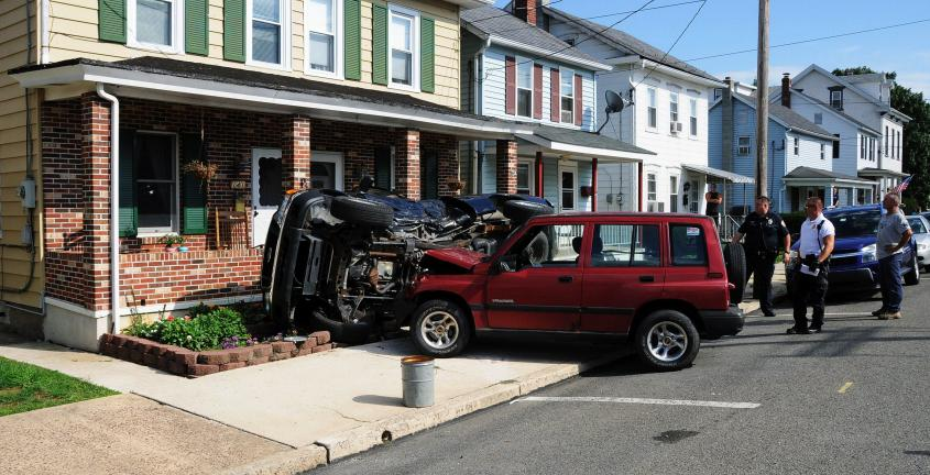 Larry Neff/Times news A female motorist was injured in Lehighton Friday afternoon after apparently failing to stop at an intersection and ramming a pickup truck parked in front of a home on the 100 block of South Third Street.