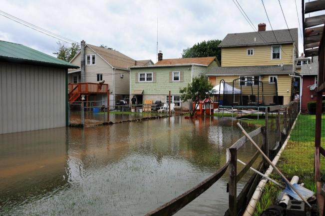 Larry Neff/Special to the Times news The waters of a raging Aquashicola Creek left one street and many back yards along Lehigh Avenue in Palmerton under water.
