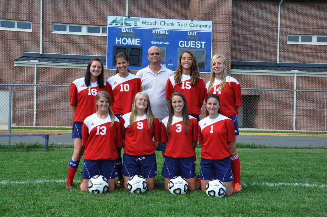 RON GOWER/times news Jim Thorpe girls' soccer team seniors, who have been with the team since they were freshmen, are, front l-r, Jeanna McElmoyle, Jennifer Rusbarsky, Kristin Lawrence, Erica Smith; back l-r, Celeste Meriano, Samantha Hughes, Coach…