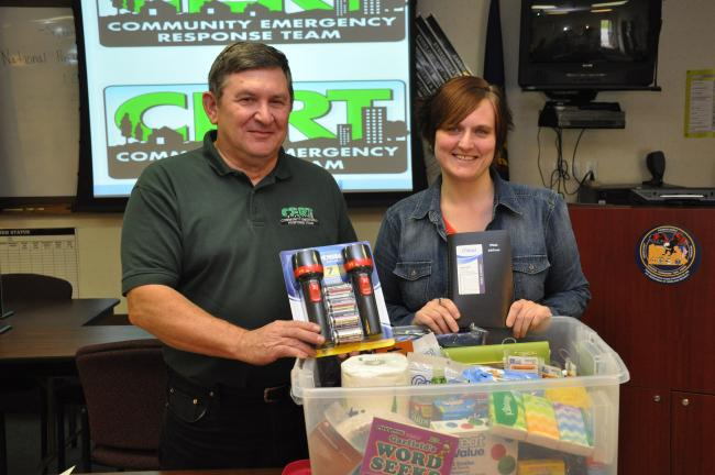 AMY MILLER/TIMES NEWS Tony Walck, left, president of the Carbon County Citizen Corps Council, and Megan Fredericks, administrative assistant at the Carbon County Emergency Management Agency, show just a few items that should be in an emergency…