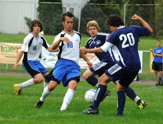@$: Pursuing soccer ball in contest between Palmerton and Northern Lehigh on Saturday are, l-r, Lee Shehadeh (16), Trevor Sherman (18), both of the Bombers, and Channing Shiffert and Jimmy Bilger (20), both of the Bulldogs. RON GOWER/TIMES NEWS