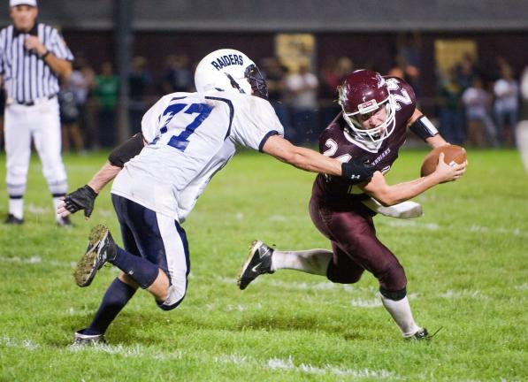 bob ford/times news Lehighton quarterback Anthony Farole (right) tries to escape the grasp of Tamaqua's Derek Vandermartin.