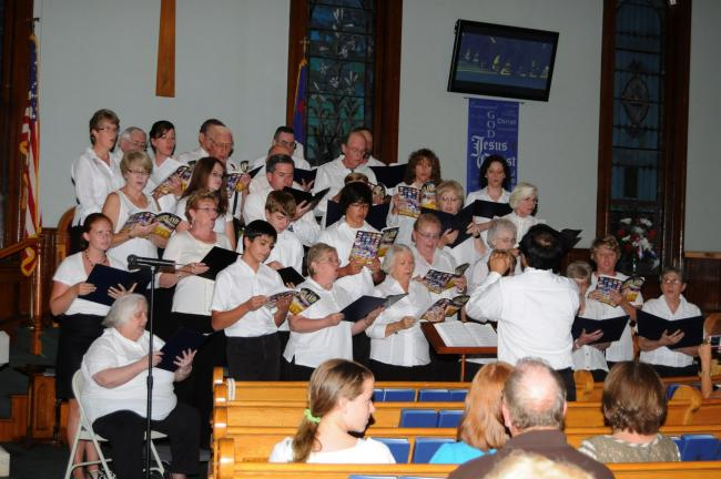 RON GOWER/TIMES NEWS A 32 member chorus from several churches sings during 9/11 service in Hope of Christ Presbyterian Church, Summit Hill. The choir was directed by David Perkins, and also sang in St. Peter's Lutheran and UCC Church, West Penn Township.