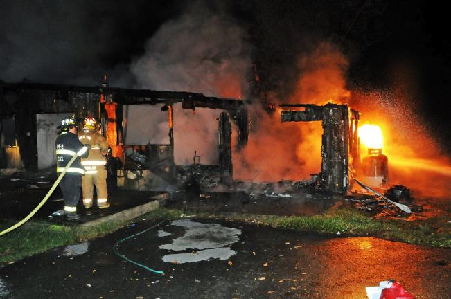 Larry Neff/special to the times news Firemen fight down flames that destroyed a home along Beltzville Drive in Polk Township late Thursday night.