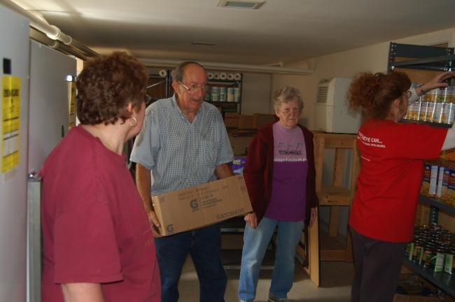 TERRY AHNER/TIMES NEWS  Christian Action Council of Palmerton Area Churches (CACPAC) volunteer (l-r) Sandra Greenzweig, pantry coordinator Charlie Silliman, volunteer Florence Silliman, and Salem United Methodist Church Pastor Deborah McLean stock…