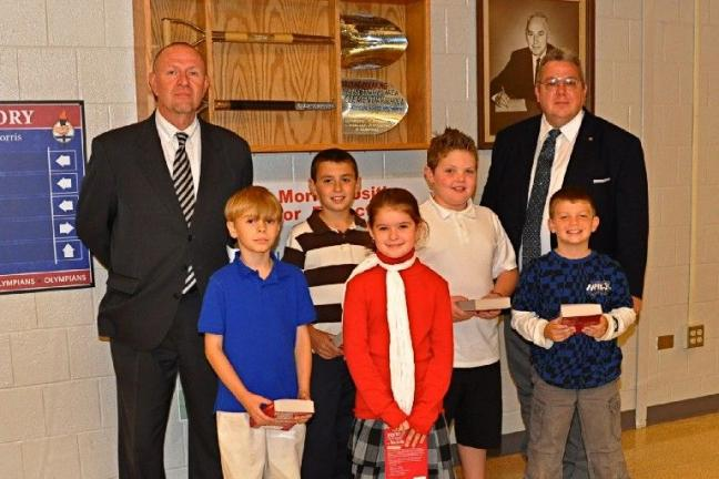 VICTOR IZZO/SPECIAL TO THE TIMES NEWS Members of the Jim Thorpe Rotary Club, Randy Smith, left, and Ronald Sheehan, right, delivered new dictionaries to third grade students of the Jim Thorpe Area School District. Third grade students are, from left…