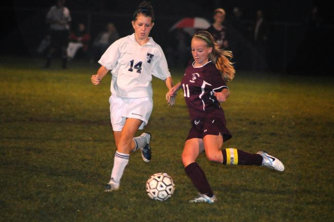 ron gower/times news Avery Banavage (14) of Tamaqua moves in to defend Pine Grove's Emma Koontz.