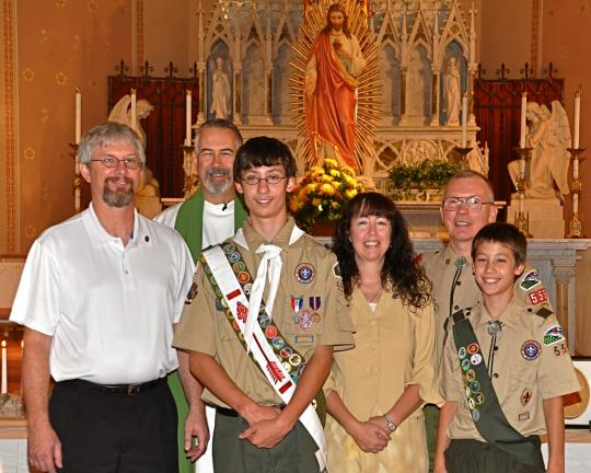 Victor Izzo/special to the times news Gathered around Steven Hutta at the Eagle Scout Court of Honor in Jim Thorpe are, left to right, his father Mike; Father Francis Baransky, Pastor of St. Joseph Catholic Church; his mother Monique; Troop 555…