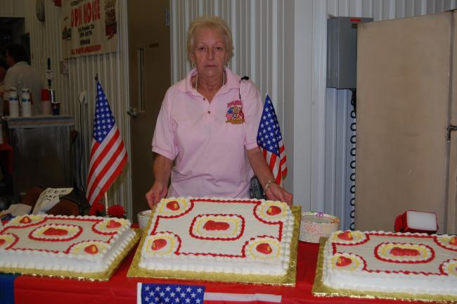 ELSA KERSCHNER/TIMES NEWS Liz Lennon, wife of Ralph Lennon, fire chief, baked three large cakes for the open house.
