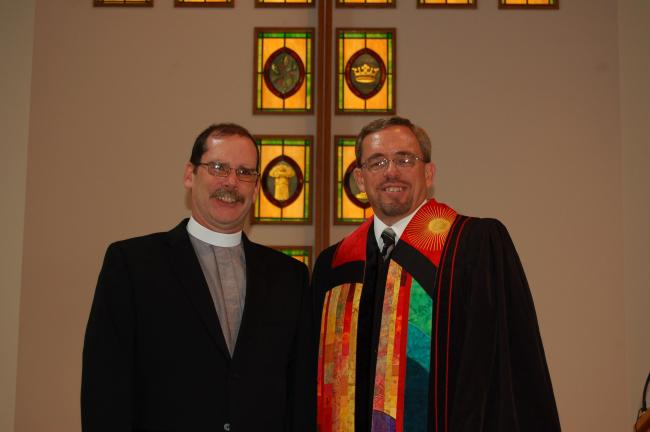 CHRIS PARKER/TIMES NEWS The Rev. Michael J. McGowan, left, was installed Sunday as pastor of Ben Salem United Church of Christ, East Penn Township. At his right is the Rev. Alan C. Miller, Conference Minister from Penn Northeast Conference of the…