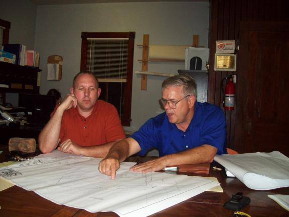 GAIL MAHOLICK/TIMES NEWS Barry Issett, engineer, with Barry Issett Associates, Trexlertown, right, explains to Mike Grant, left, the steps Parryville Council will have to take to comply with Act 537 Sewage Facilities Plan.