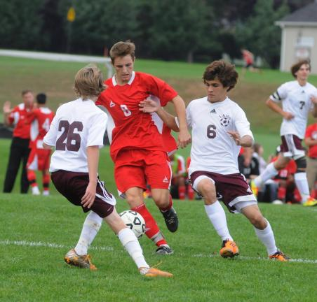 RON GOWER /TIMES NEWS Lehighton's Cole Christman (26) and Anthony Rossino (6) try to block Pocono Mountain East's Martin Dieppa from moving the ball downfield in soccer action yesterday in Lehighton.