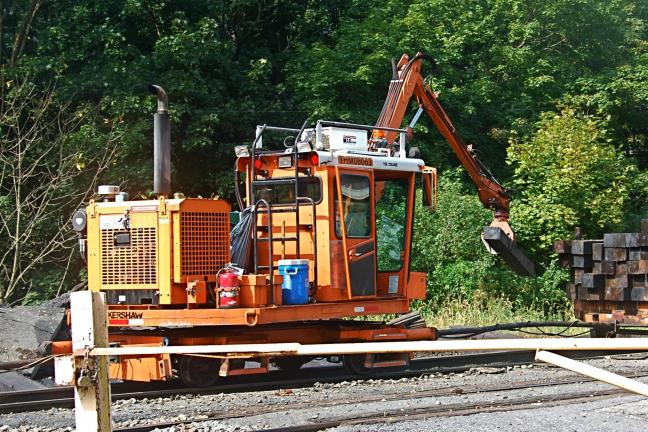 VICTOR IZZO/SPECIAL TO THE TIMES NEWS Work crews and machinery from the Norfolk and Southern Railroad have been busily working on the railroad tracks passing through the Jim Thorpe area for the last few days. The track maintenance workers, using 26…