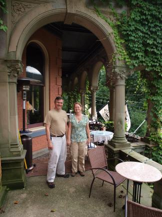 Ronald and Sharon Klein of northeastern Pennsylvania visit the balcony of the Harry Packer Mansion during Sunday's Jim Thorpe Victorian House Tour.