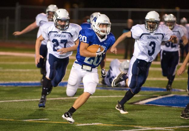 Rob Getz (20) of Pleasant Valley finds running room against Tamaqua. The Raiders' Tyler Hope (27) and Dylan Houser (3) chase from behind.