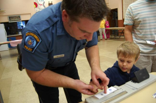 Gail Maholick/TIMES NEWS Asa Andrew, a student at Jack and Jill Preschool, is fingerprinted by Bethlehem Township police officer Troy Abelovsky during the Jack and Jill Preschool Family Safety Night held recently at Trinity Lutheran Church.