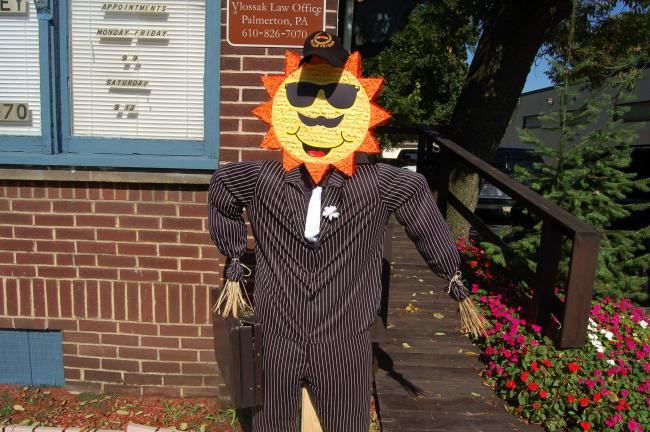 TERRY AHNER/TIMES NEWS This scarecrow is decked out in a suit and stands outside the office of attorney Steve Vlossak at 423 Delaware Ave. in Palmerton.