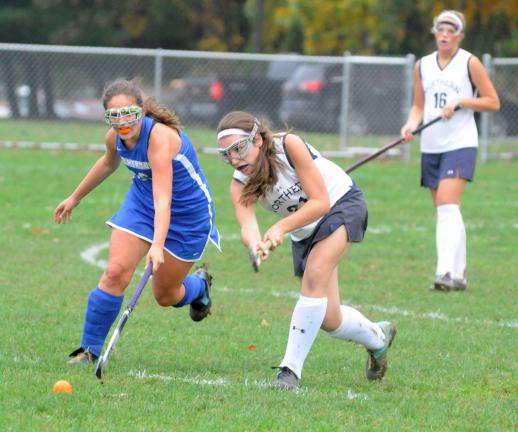 RON GOWER/TIMES NEWS Palmerton's Greta Hartsell, left, and Northern Lehigh's Kelsey Follweiler battle for ball in field hockey action at Northern Lehigh. In the background is NL's Casey Gavalla (16).