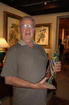 Grant White holds a Gai-nah-ne, a hand-carved Hopi kachina eagle, part of his Southwest collection.