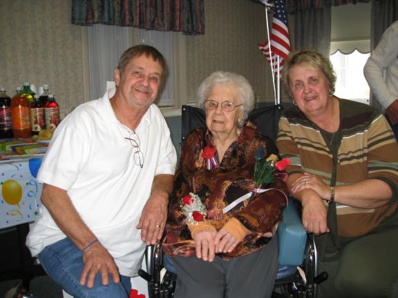 Mrs. Anna Mary Ogozalek is celebrating her 100th birthday this week. Helping her to observe the day are her son Leonard and daughter, Virginia Zabo.