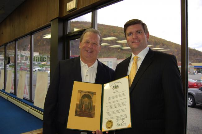 Gail Maholick/TIMES NEWS John Kovatch III, left, Kovatch Ford CEO receives a Senate Citation from Senator John Yudichak. Kovatch Ford recently celebrated its 25th anniversary as a family owned business.