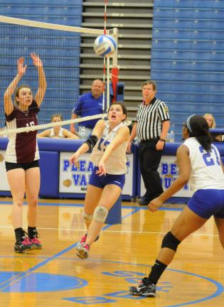 RON GOWER/TIMES NEWS Pleasant Valley's Stephanie Schmitt sets up teammate Breanne Jpseph during Tuesday's MVC volleyball semifina match against Stroudsburg.