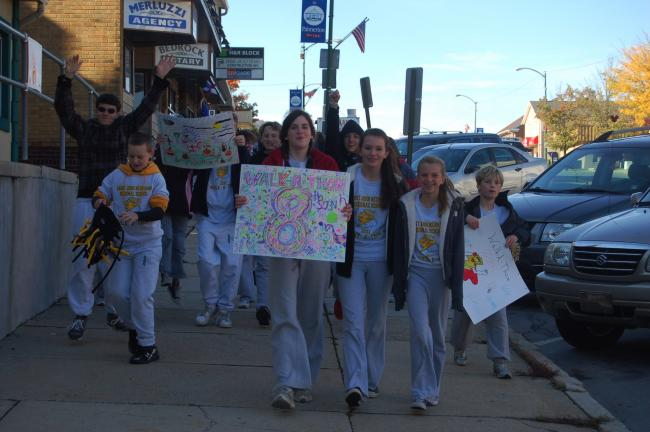 TERRY AHNER/TIMES NEWS  Students from the Palmerton campus take a stroll down the 200 block of Delaware Avenue on Friday as part of a Walkathon conducted by St. John Neumann Regional School.