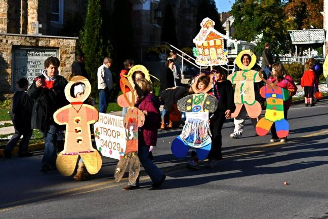 "VICTOR IZZO/SPECIAL TO THE TIMES NEWS Brownie Troop 34029 - ""Gingerbread People"" won 2nd place honors in ""groups"" in the 17th annual Halloween parade in Jim Thorpe on Sunday."