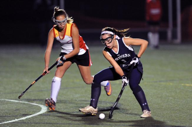 nancy scholz/times news Northern Lehigh's Lauren Zellner tries to stick handle around a Moravian Academy defender.