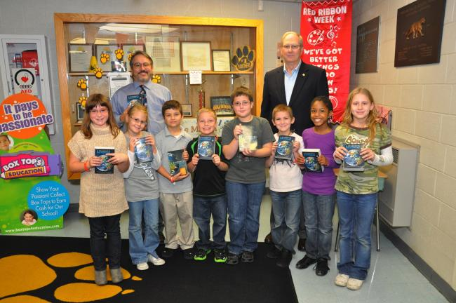 "AMY MILLER/TIMES NEWS William P. Gardiner, back right, stands with a few Panther Valley third grade students who received dictionaries. A total of 147 students at Panther Valley will get a copy of ""A Student's Dictionary."" With Gardiner and…"
