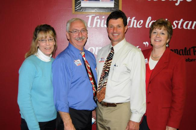 RON GOWER/TIMES NEWS Wayne Nothstein, second from left, and Tom J. Gerhard, stand with their wives, Donna, left, and Sue Ann, right, at the Carbon County Republican headquarters in Lehighton, last night.
