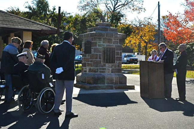 Flanked by Committee Chairwoman Edith Lukasevich and Jim Thorpe Lions Club President James Trainer, Committee Chairman Ronald Sheehan speaks to those assembled at Memorial Park in Jim Thorpe during the dedication ceremony for the borough's newly…