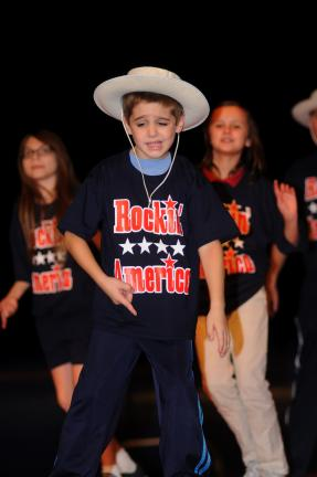 "RON GOWER/TIMES NEWS Brett Balliet, a Jim Thorpe School District elementary student, practices for the musical ""Rockin' America"" to be held Friday at Jim Thorpe High Shcool. This is the first-ever musical by Jim Thorpe elementary students."
