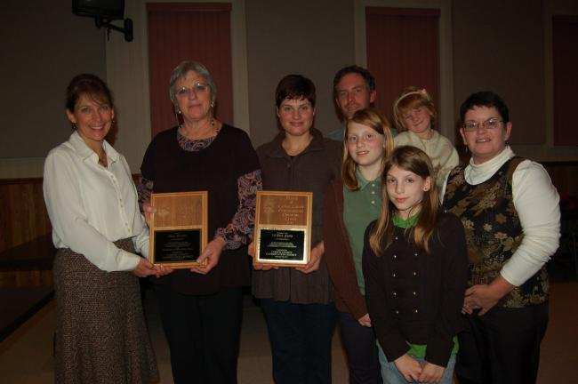 Gail Maholick/TIMES NEWS Carbon County Environmental Education Center presented the Educator of the Year award to Mari Gruber, owner of Bear Mountain Butterfly Sanctuary. The Friend of CCEEC award was presented by naturalist Jeannie Carl to 14 Acre…