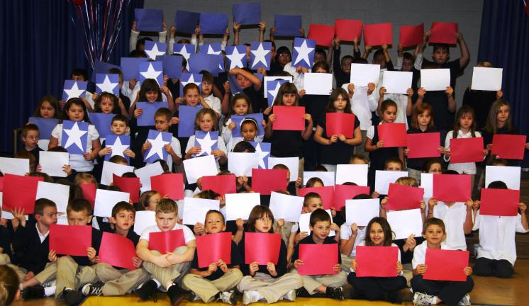 ANDREW LEIBENGUTH/TIMES NEWS Tamaqua second graders display their stars and stripes during the Veterans Day celebration.