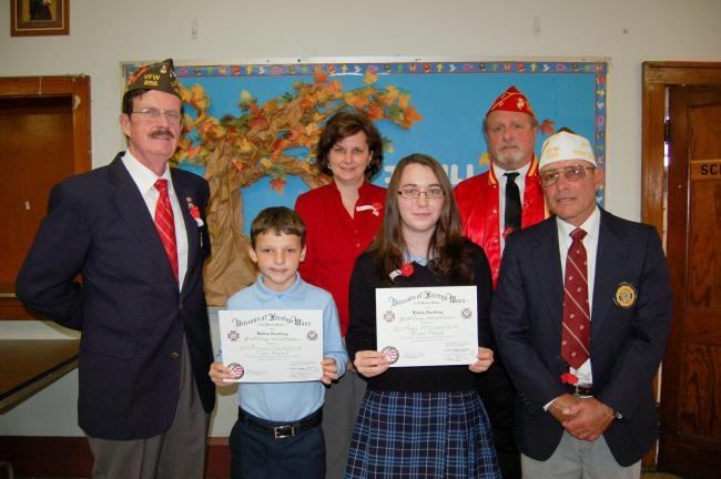 Gail Maholick/TIMES NEWS Lehighton Veterans of Foreign Wars (VFW) Post 256 presented prizes students who entered the VFW Patriot's Pen Essay Contest at Ss. Peter and Paul School. From left are, Harry Wynn III, senior vice commander; Bruce Smith,…